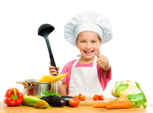 beautiful little girl with spaghetti and vegetables over white